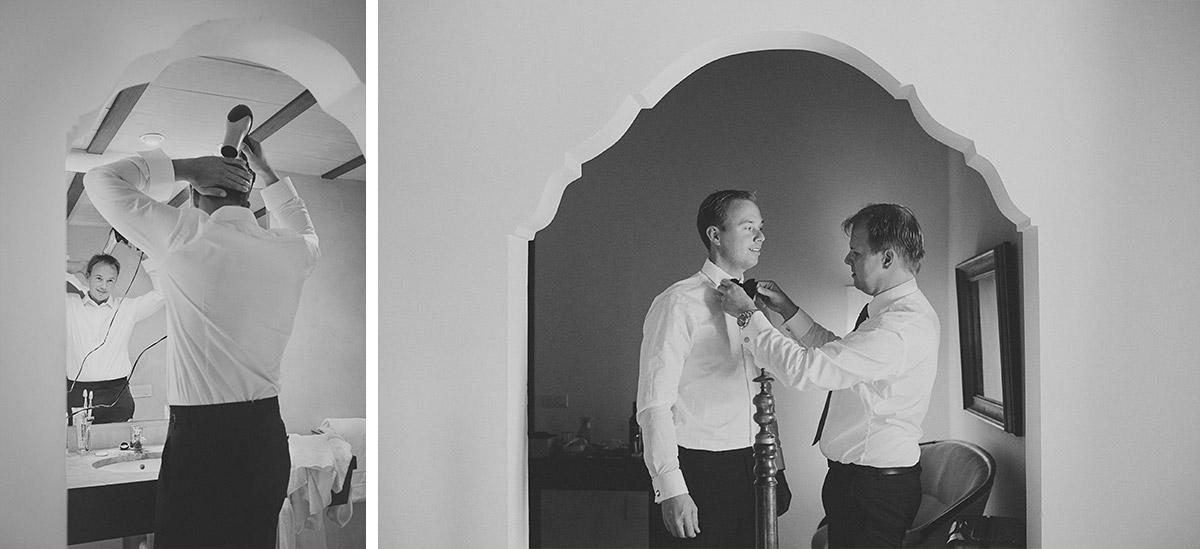 Hochzeitsreportage-Foto von Bräutigam während Hochzeitsvorbereitungen beim Föhnen der Haare und Anziehen © Hochzeitsfotograf Berlin hochzeitslicht